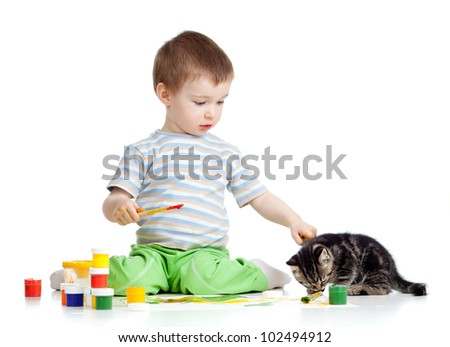 kid drawing paints with cat
