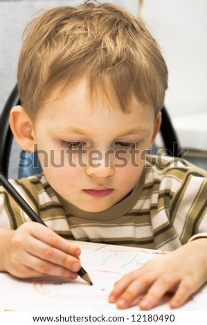 Kid draws a picture