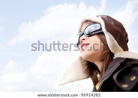 Kid dreaming of becoming a pilot with an old style uniform - stock photo
