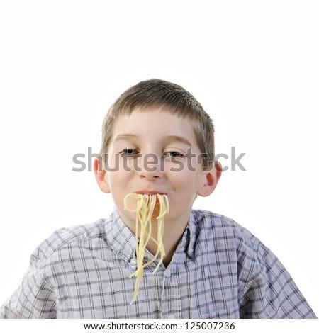 Kid eating spaghetti - stock photo