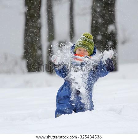 Kid enjoying the snow - stock photo