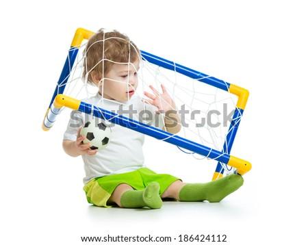 kid football player holding soccer ball - stock photo