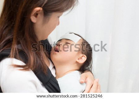 kid gets high fever - stock photo