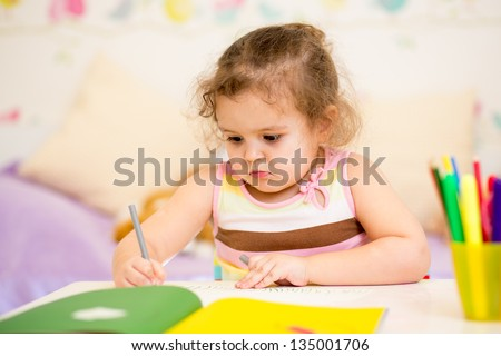 kid girl drawing with felt-tip pen - stock photo