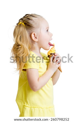kid girl eating ice-cream in studio isolated - stock photo