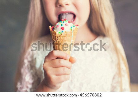 Kid girl eating tasty ice cream - stock photo
