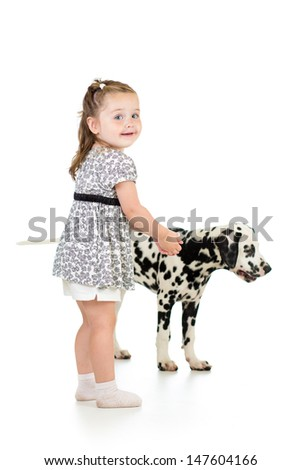 kid girl playing with dog - stock photo
