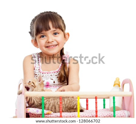 kid girl playing with kittens