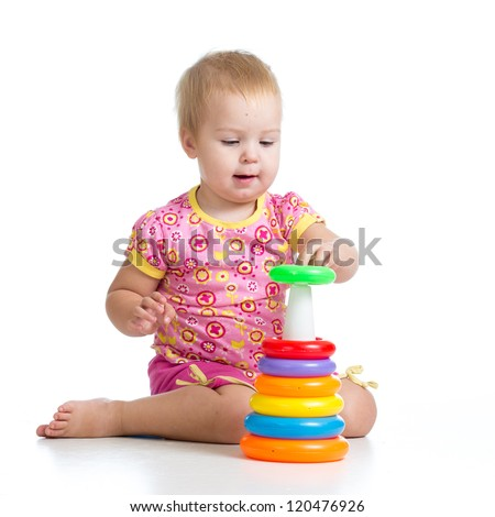 kid girl playing with pyramid toy isolated on white background - stock photo