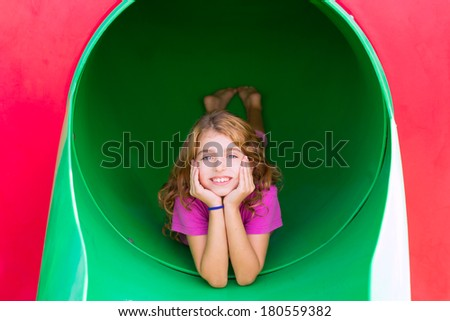kid girl smiling in the park playground relaxed with hands in face - stock photo