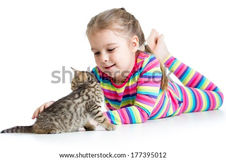 kid girl stroking cat kitten