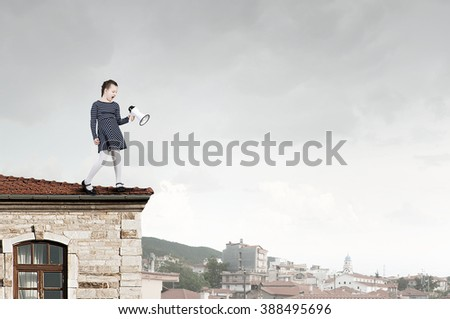 KId girl with loudspeaker - stock photo