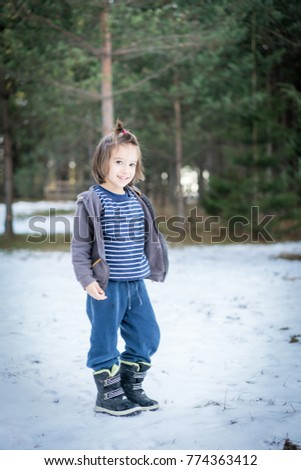 Kid having fun time in winter snow