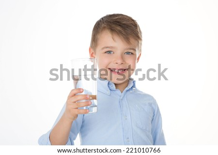 kid holding a glass in his hand - stock photo