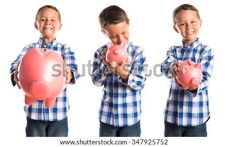 Kid holding a piggybank  - stock photo