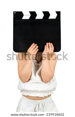 Kid holding blank clapper board with copyspace - stock photo