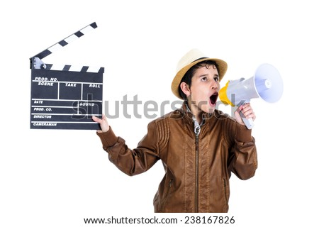 Kid holding clapper board and shouting through megaphone  - stock photo