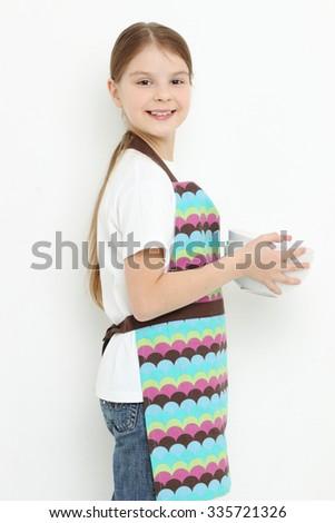 Kid holding white bowls - stock photo