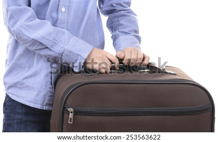 kid holds suitcase