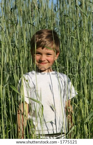 Kid in a huge rye - stock photo