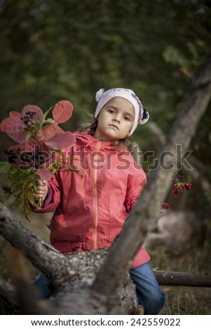 kid in autumn forest - stock photo
