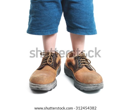 kid in big shoes on white background - stock photo