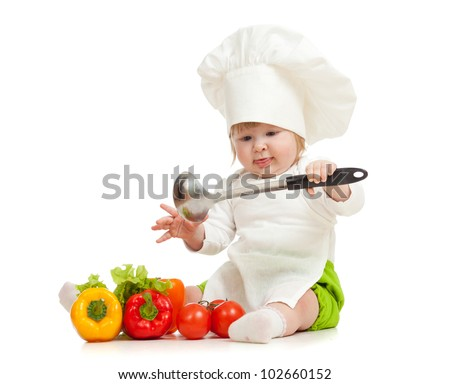 Kid in chef hat with healthy food vegetables - stock photo