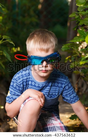 Kid in glasses and shirt looks like spy - stock photo