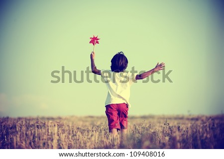 Kid in nature walking - stock photo