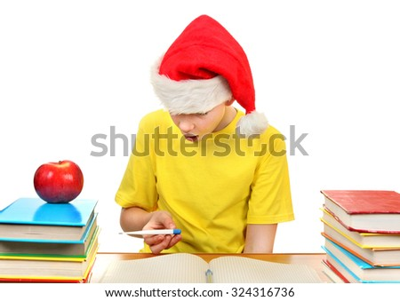Kid in Santa Hat check the Thermometer on the School Desk on the White Background - stock photo