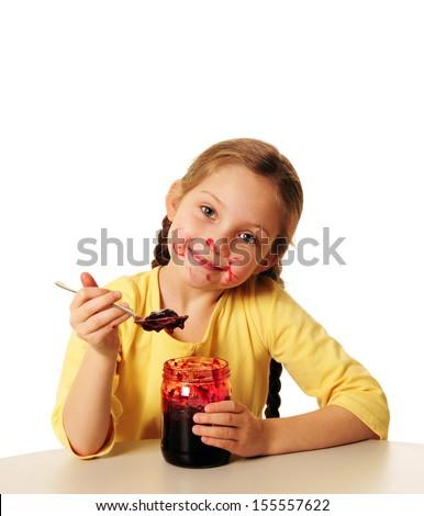 kid is eating marmelade - stock photo