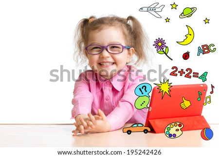 Kid learning or playing with tablet computer - stock photo