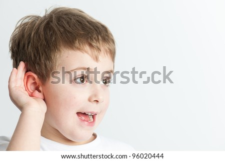 Kid listening at a distance,  isolated on white background - stock photo