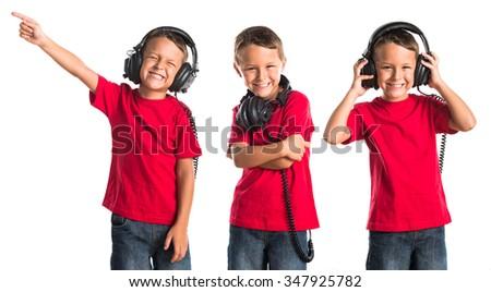 Kid listening music  - stock photo