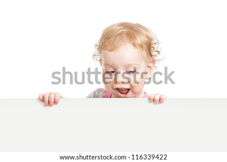 kid looking down behind white empty banner isolated - stock photo