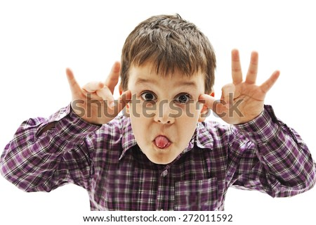 Kid making a face and showing his tongue.  Isolated on white background - stock photo
