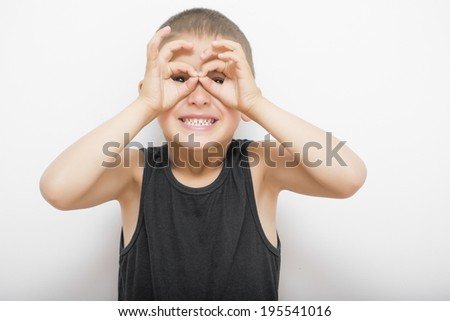 Kid making funny face  - stock photo