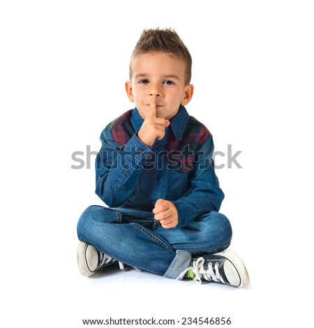 Kid making silence gesture over white background - stock photo