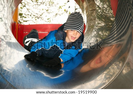 Kid on a slide - stock photo