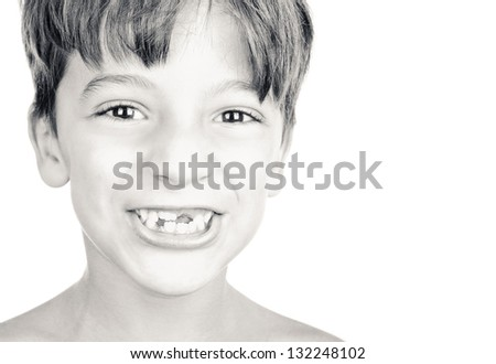 Kid or child or boy showing his missing milk teeth isolated on white background. Black and white. - stock photo
