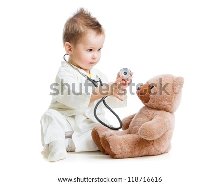 kid or child playing doctor with stethoscope and teddy bear isolated on white - stock photo