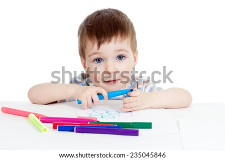 kid painting by colorful felt tip pens - stock photo