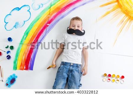 kid painting rainbow - stock photo
