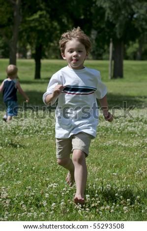 kid play outdoors in the bright sun just having fun