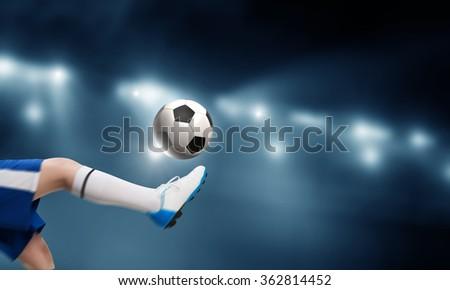Kid play soccer on stadium - stock photo