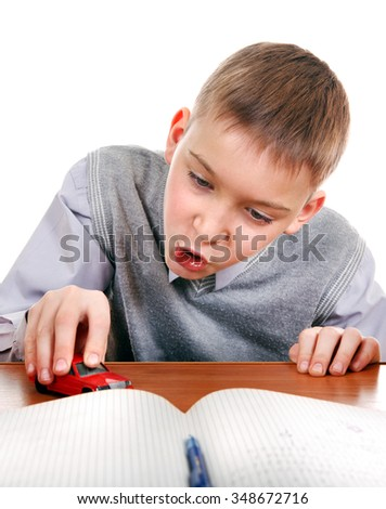 Kid play with a Toy on the School Desk on the white background - stock photo