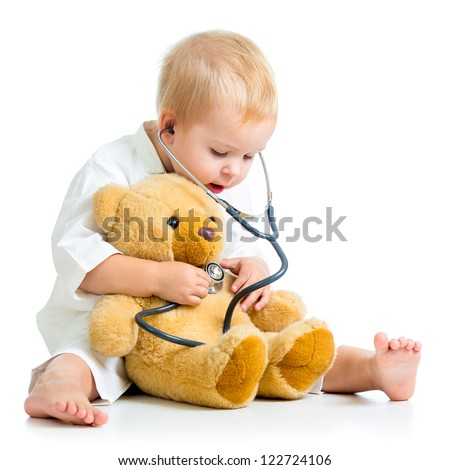 kid playing a doctor isolated on white - stock photo