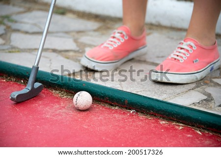 Kid playing mini golf - stock photo