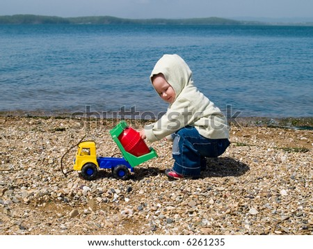 kid playing on the beach - stock photo