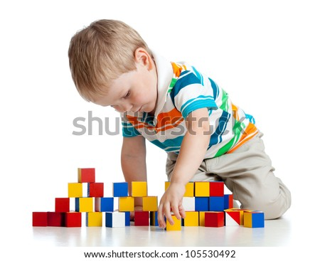 kid playing toy blocks  isolated on white background - stock photo